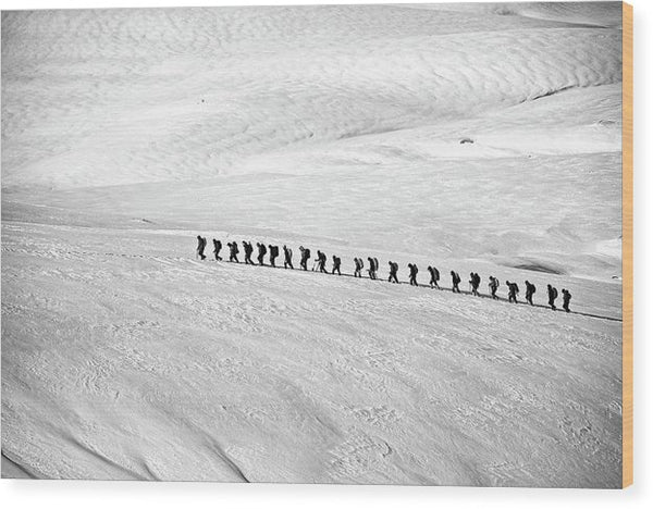 People Trekking Through Snow - Wood Print from Wallasso - The Wall Art Superstore