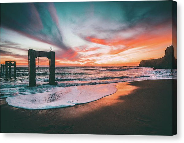 Vibrant Beach Sunset With Remains Of Old Pier - Canvas Print from Wallasso - The Wall Art Superstore
