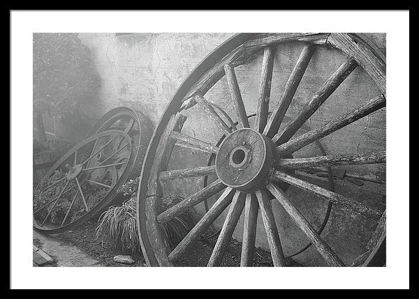 Wagon Wheel Leaning Against Wall - Framed Print from Wallasso - The Wall Art Superstore