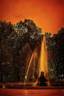 Water Fountain With Vibrant Orange Sunset - Art Print from Wallasso - The Wall Art Superstore