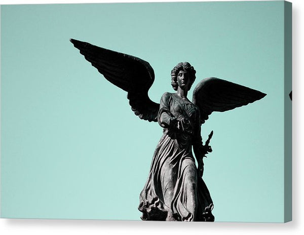 Winged Angel Statue With Blue Sky - Canvas Print from Wallasso - The Wall Art Superstore