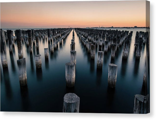 Wood Posts In Ocean At Sunrise - Canvas Print from Wallasso - The Wall Art Superstore