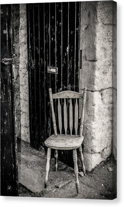 Wooden Chair Against Brick Wall - Canvas Print from Wallasso - The Wall Art Superstore