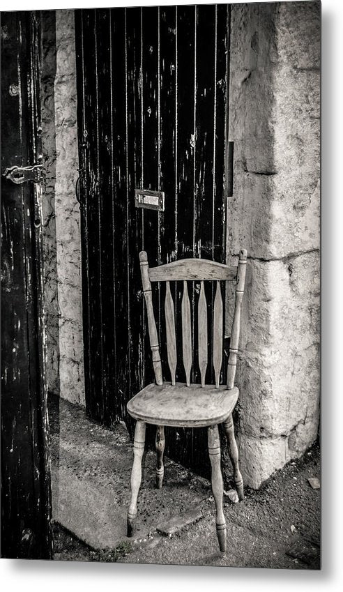 Wooden Chair Against Brick Wall - Metal Print from Wallasso - The Wall Art Superstore