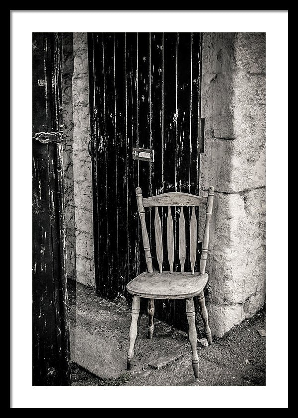 Wooden Chair Against Brick Wall - Framed Print from Wallasso - The Wall Art Superstore