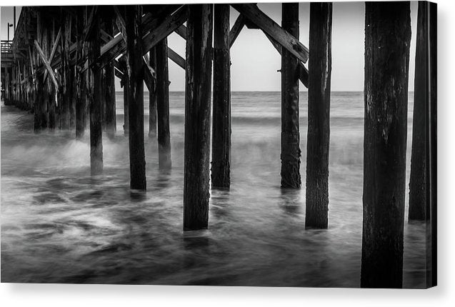 Wooden Poles Holding Up Pier - Canvas Print from Wallasso - The Wall Art Superstore