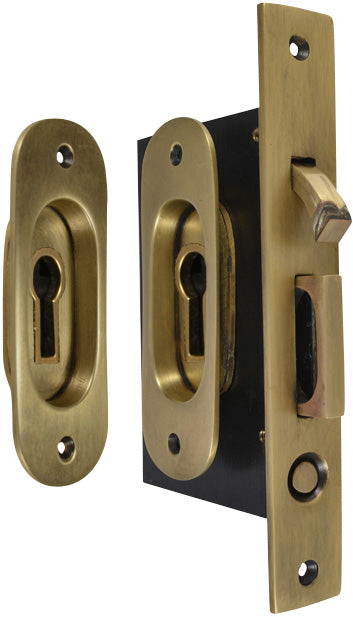 Traditional Oval Pattern Single Pocket Privacy (Lock) Style Door Set (Antique Brass)