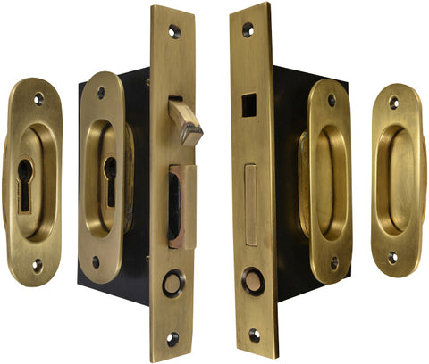 Traditional Oval Pattern Double Pocket Privacy (Lock) Style Door Set (Antique Brass)