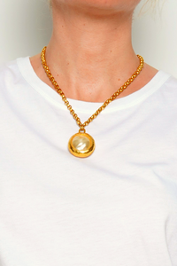 Vintage-Inspired Pearl Pendant with Golden Chain.