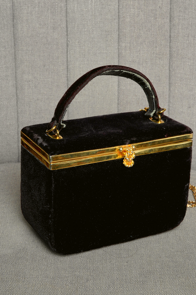 Black Velvet bag with gold metal clasp and shoulder chain.