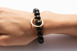 Black Onyx Beaded Bracelet + 14k Yellow Gold Circle Charms Displayed on Arm