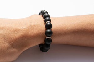 Black Onyx Beaded Bracelet With Three Pavé Diamond Spacer Beads Set in 14k Gold Pictured On Arm