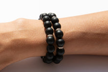 Load image into Gallery viewer, Set of Two Black Onyx Beaded Bracelet With Three Pavé Diamond Spacer Beads Set in 14k Gold Pictured On Arm
