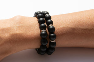 Set of Two Black Onyx Beaded Bracelet With Three Pavé Diamond Spacer Beads Set in 14k Gold Pictured On Arm