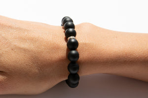 Black Onyx Beaded Bracelet With Pavé Diamonds Set in 14k Yellow Gold Pictured On Arm