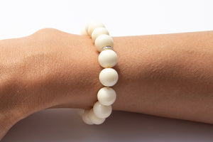 White Bone Beaded Bracelet With Pavé Diamonds Set in 14k Yellow Gold Featured on Arm