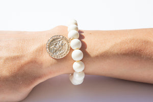 White Bone Bead Bracelet Adorned With a  Yellow Gold Filled St Christopher Medallion Coin Charm Featured on Arm