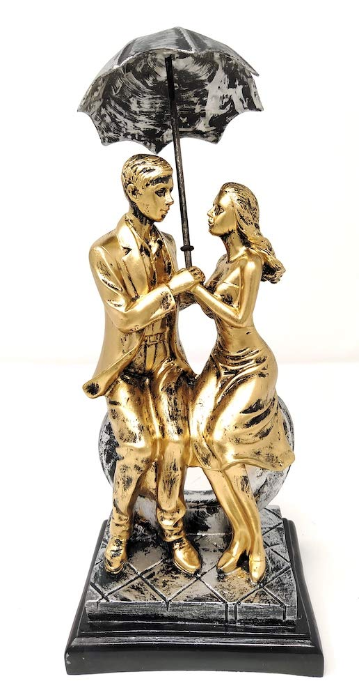 Love Couple Pair Sitting on Heart Carrying Umbrella Figurine (Golden, Height 11 in X Length 5 in)