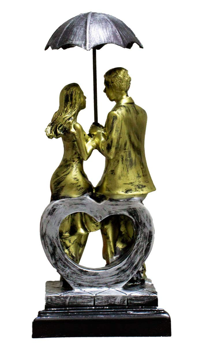Love Couple Sitting on Heart Carrying Umbrella Figurine (Golden, Height 11 in X Length 5 in)