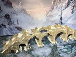 A 3D printed destroyed bridge that is a piece of scatter terrain, designed for tabletop wargaming and Role Playing Games.