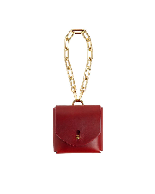 Anoeses red leather bag on a chain