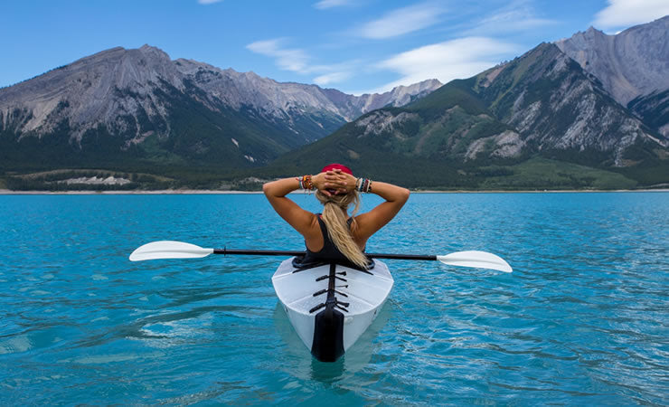 Woman kayaking getting back to nature with Tauri-Gum