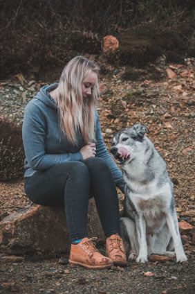 Woman with her dog enjoying nature and relaxation