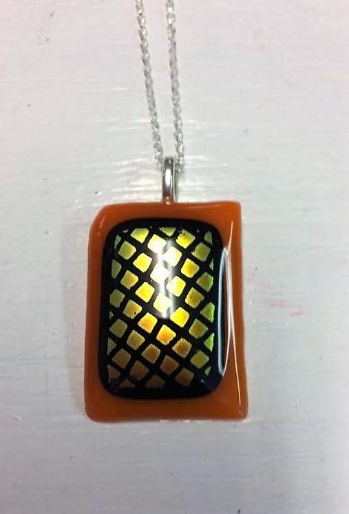 Handcrafted fused glass orange glass pendant on chain