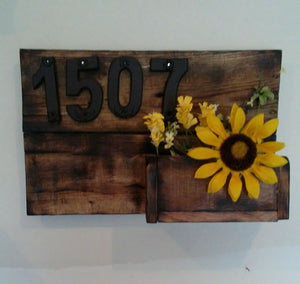 handcrafted address sign and planter