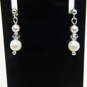 Handcrafted swarovski crystal and pearl earrings on 925 sterling silver butterflies