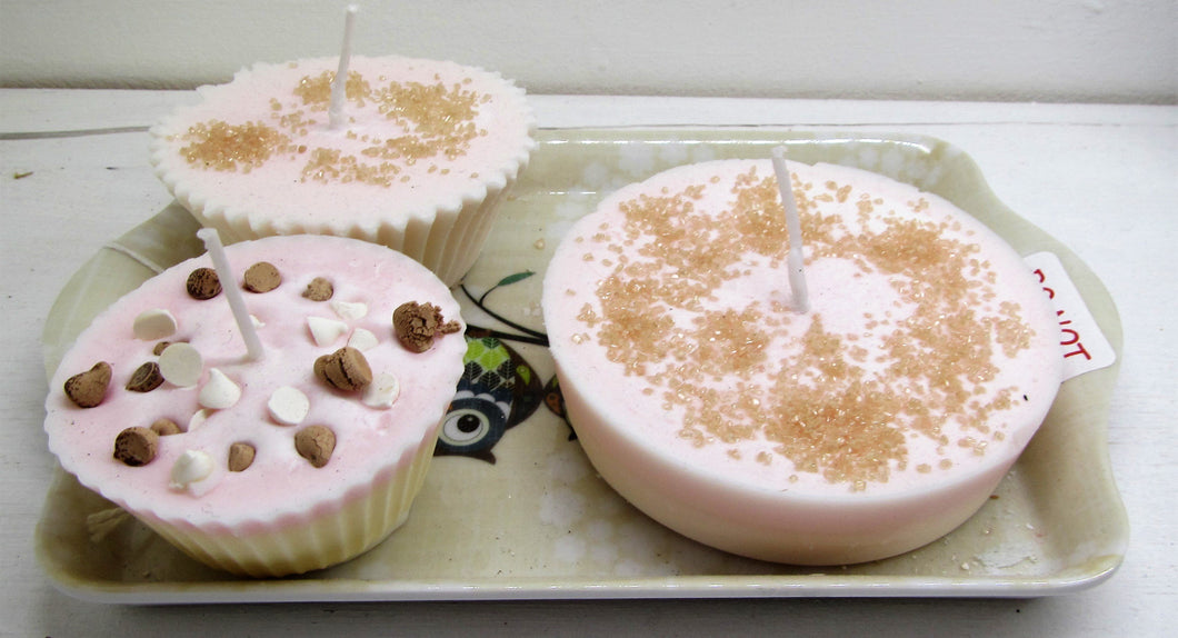 Handcrafted beautiful cake candles on a tray