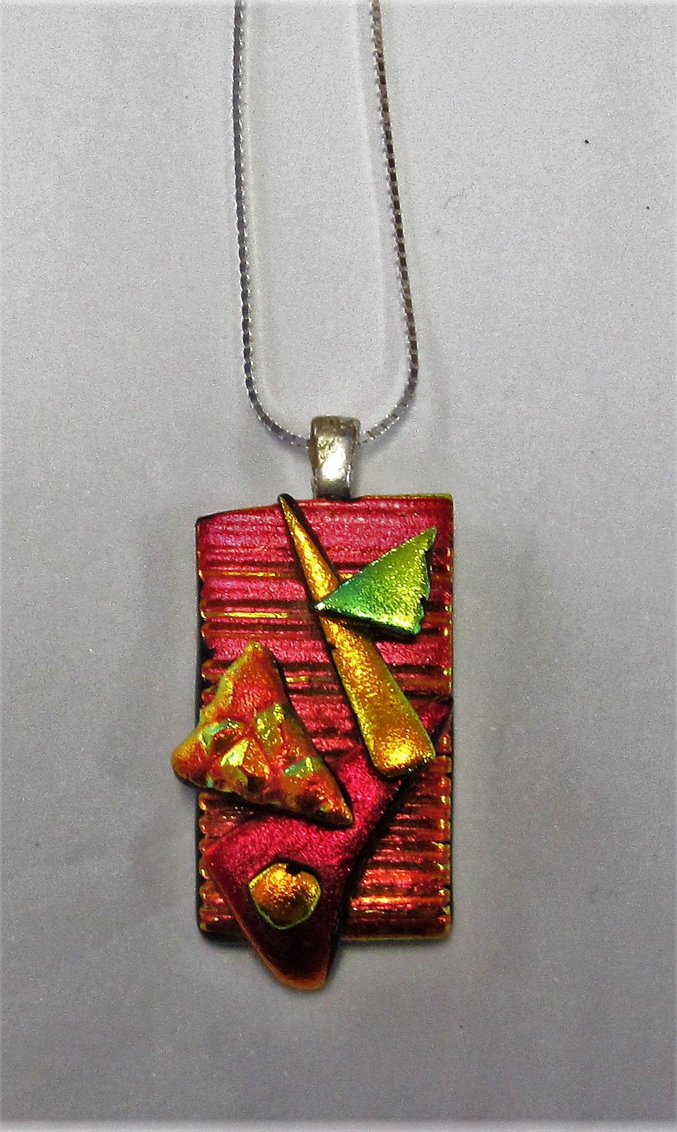 Handcrafted dichroic glass pendant on a sterling silver necklace