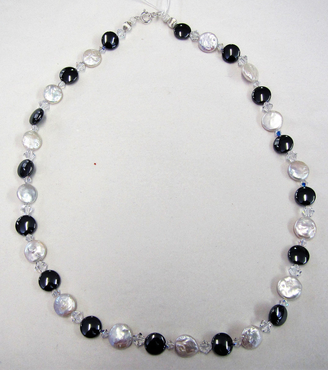 Handcrafted necklace with freshwater pearls, swarovski crystals and hematite