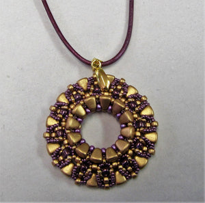 Handcrafted purple and gold beaded pendant on purple leather