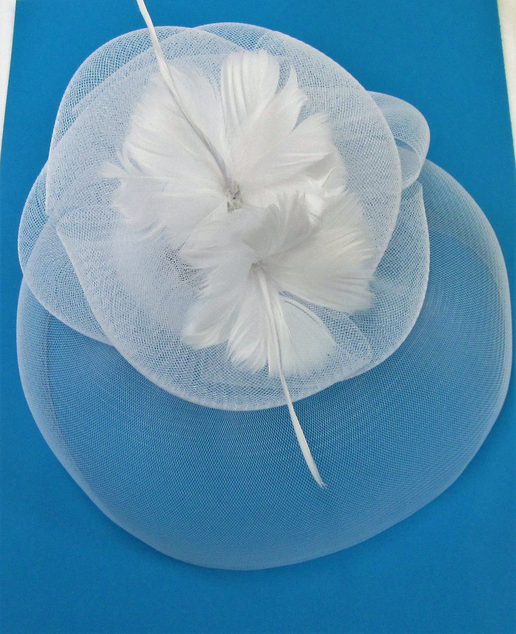 Handcrafted white bridal crinoline fascinator with two flower feathers on a hair band