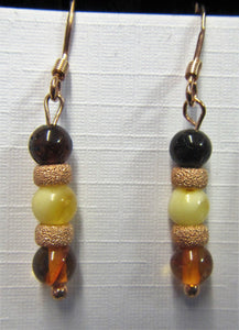 Handcrafted rose gold and amber earrings on rose hooks