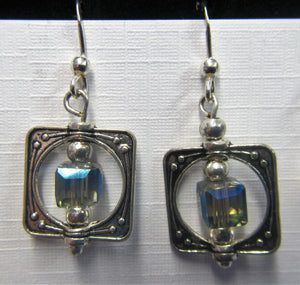 Handcrafted sterling silver blue stone caged earrings on Sterling silver hooks