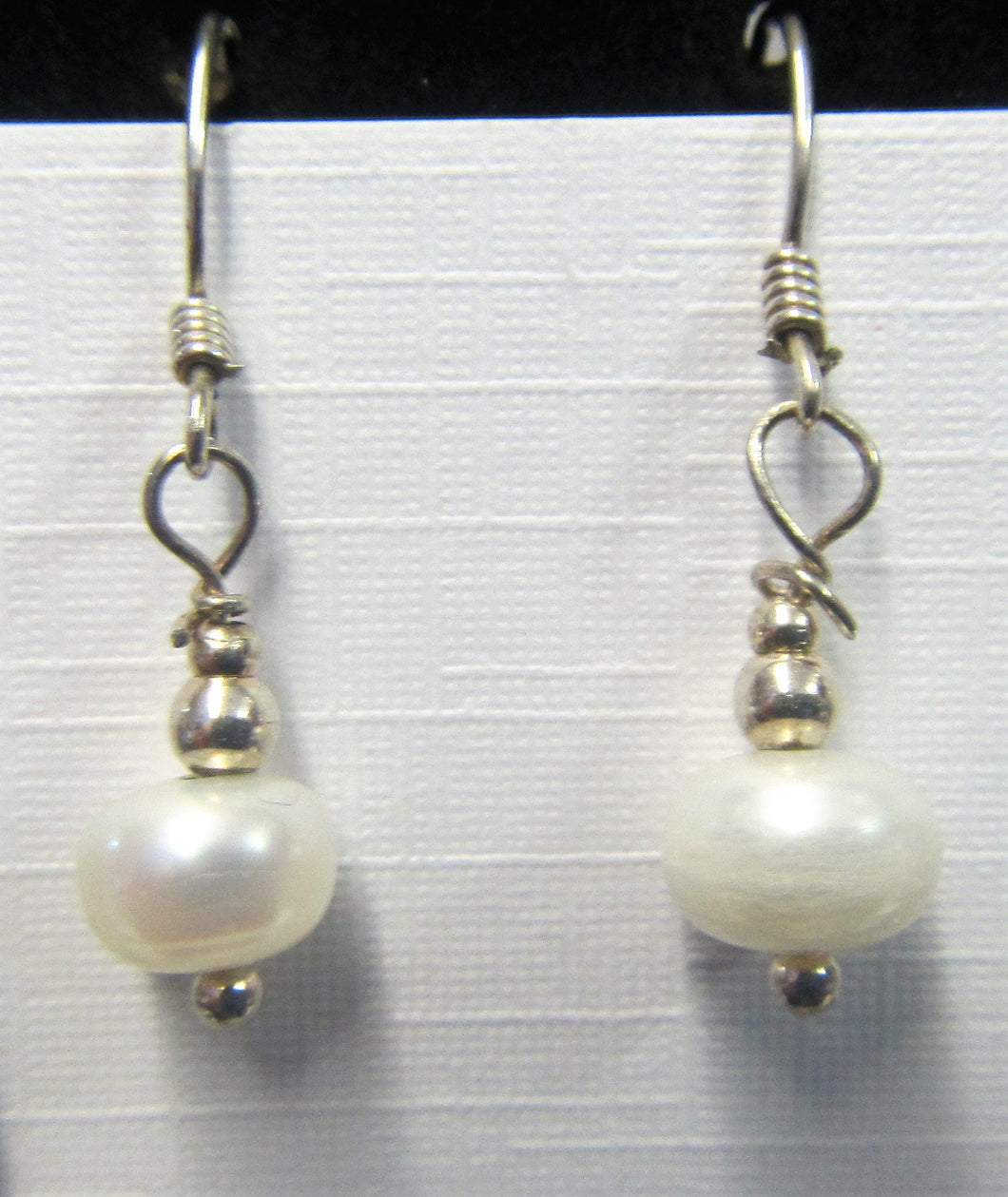 Handcrafted sterling silver pearl earrings on Sterling silver hooks