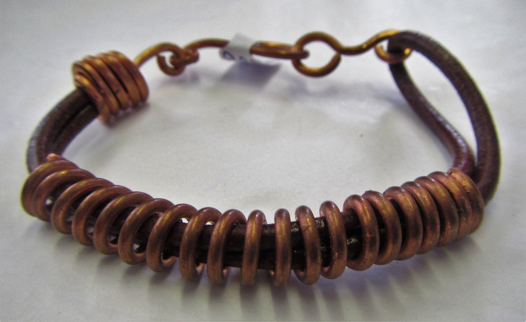 Handcrafted leather and copper twist bracelet