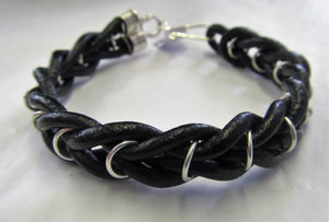 Handcrafted sterling silver and leather bound bracelet