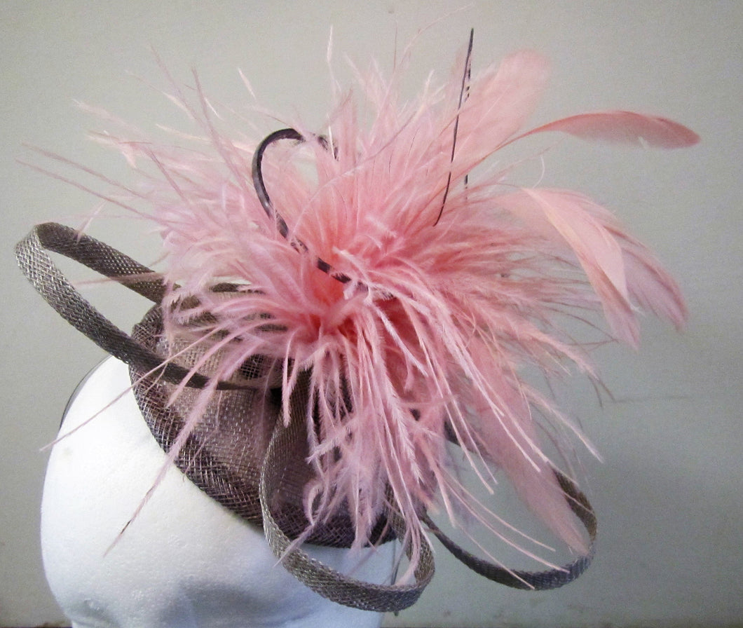 Handcrafted pewter and pink fascinator on a hair band