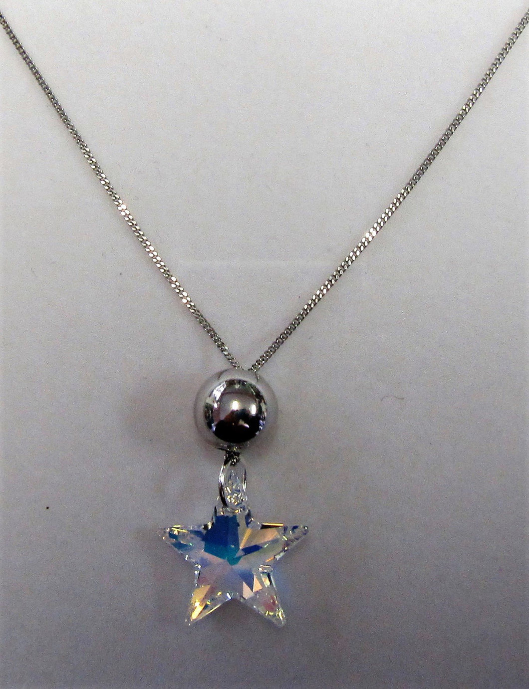 Handcrafted 925 sterling silver necklace with clear swarovski crystal star pendant