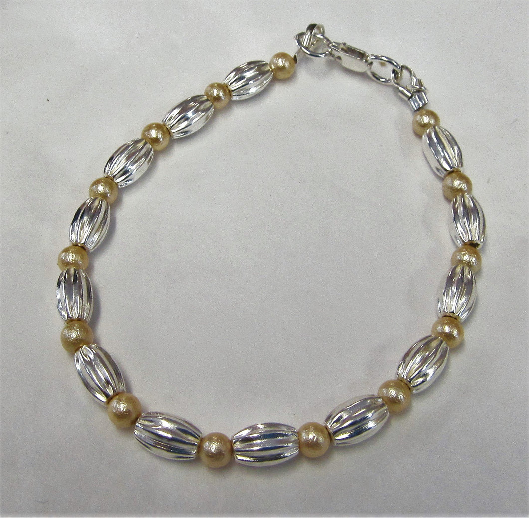 Handcrafted bracelet with swarovski pearls sterling silver beads