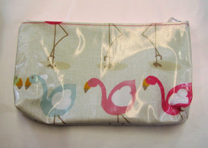 Handcrafted waxed flamingo makeup bag with zipped top.