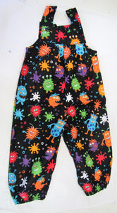 Handcrafted Black and various coloured monsters romper  12-18 months