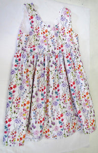 Handcrafted white dress with various coloured flowers and fully lined 4-5 years