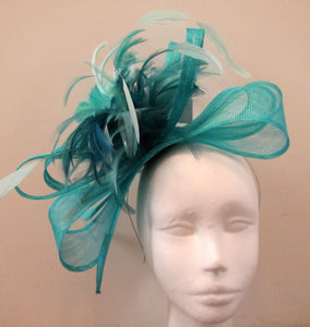 Handcrafted blue bow fascinator with feathers on a hair band various colours