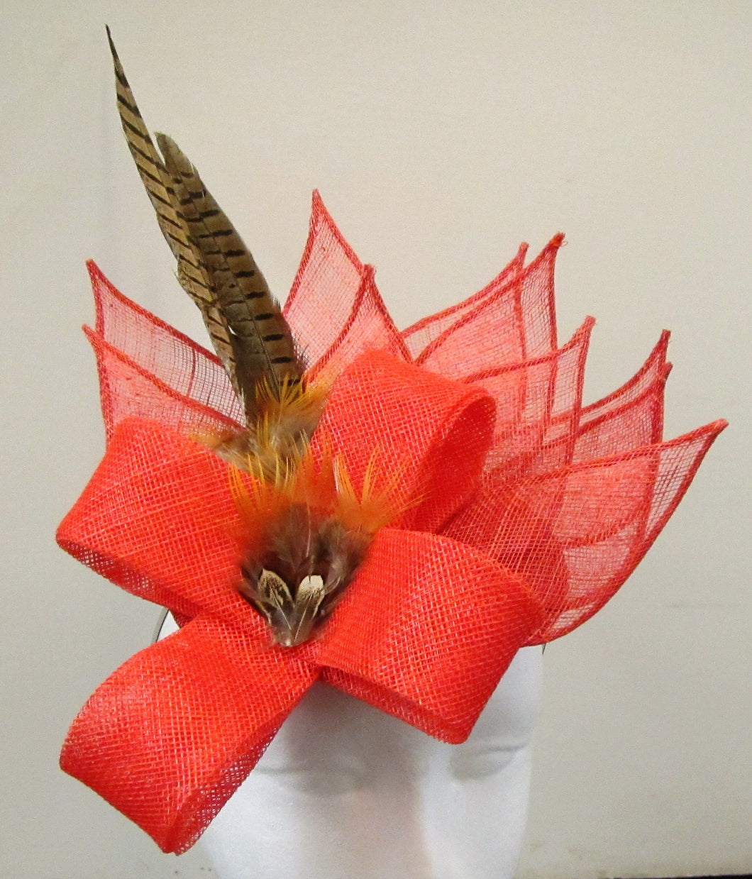 Handcrafted burnt orange fascinator with leaves, bow and pheasant feathers on a hair band