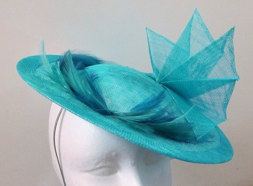 Handcrafted turquoise disk with fan and feathers fascinator on a headband