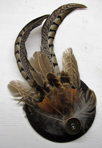 Handcrafted small pheasant feather with cartridge fascinator on a comb slide